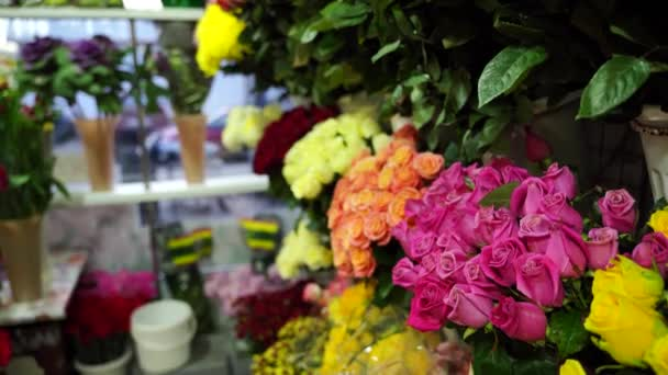 Bouquets of various flowers on counter. Fresh beautiful flowers in florist shop.