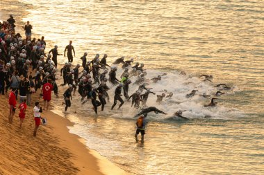 Calella, Spain, May 18. Triathletes on the beach on start of the Ironman triathlon competition at Calella beach, May 18, 2014 in Calella, Spain