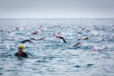 Calella, Spain, May 18. Triathletes swim on start of the Ironman triathlon competition at Calella beach, May 18, 2014 in Calella, Spain