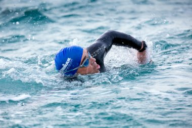 Calella, Spain, May 18. Triathlete swims on start of the Ironman triathlon competition at Calella beach, May 18, 2014 in Calella, Spain