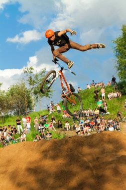Moscow, Russia, June 06, Biker is making stunt at his mountain bike at Pit Jam contest, June 06, 2011 in Moscow, Russia