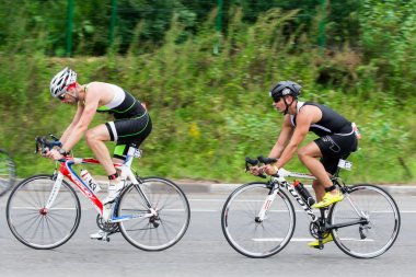 Moscow, Russia, August 16. Two triathletes ride speed cycles during triathlon competition