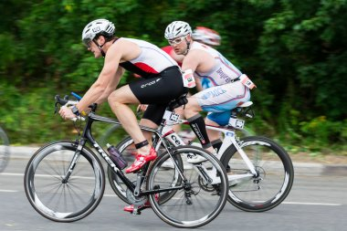 Moscow, Russia, August 16. Triathletes ride speed cycles during triathlon competition