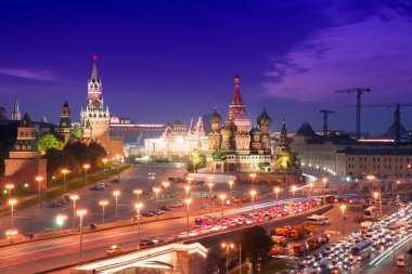 Night aerial panorama to Bolshoy Moskvoretsky Bridge, Vasilevsky Descent, towers of Moscow Kremlin, Saint Basil Cathedral, GUM and evening traffic jam,Moscow, Russia