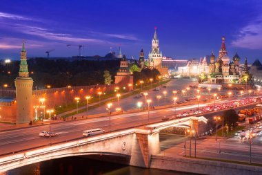 Night aerial panorama to Bolshoy Moskvoretsky Bridge, Vasilevsky Descent, towers of Moscow Kremlin, Saint Basil Cathedral and Moskva river,