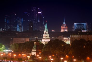 Night aerial panorama of illuminated Moscow Kremlin Towers and wall, Moscow Business City and Stalin skyscraper building