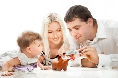 Young family with moneybox