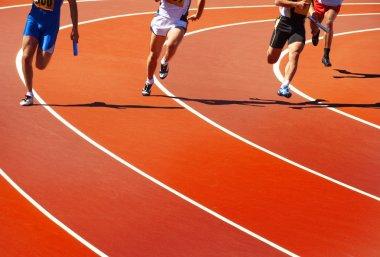 Running athletes at stadium