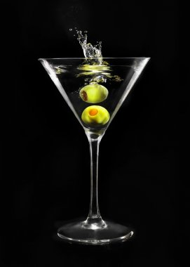 Green olive in martini glass
