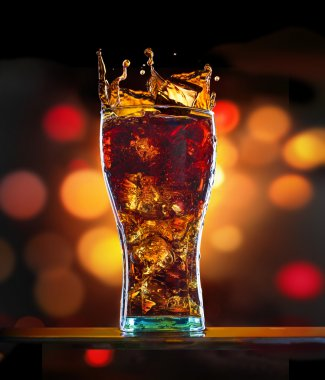Splashing of cola in glass