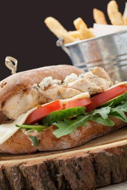 Wheat chicken sandwich burger, fried potatoes, mustard sauce. Se