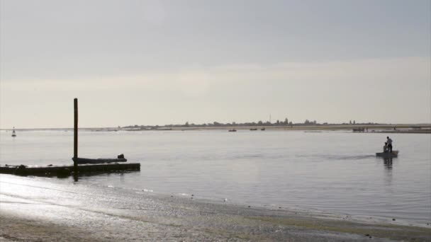 landscape view from Olhão fishing port to Armona, one of the islands of Ria Formosa wetlands natural conservation region, Algarve, southern Portugal.