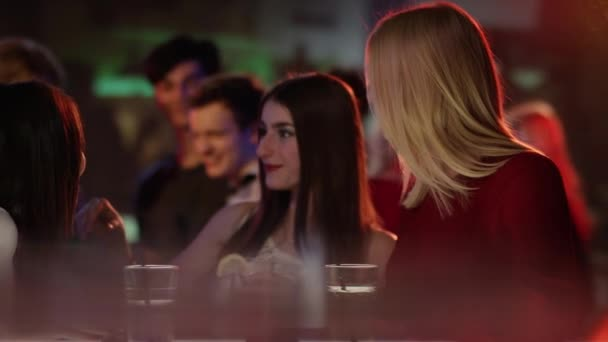 Girls gossip at the bar
