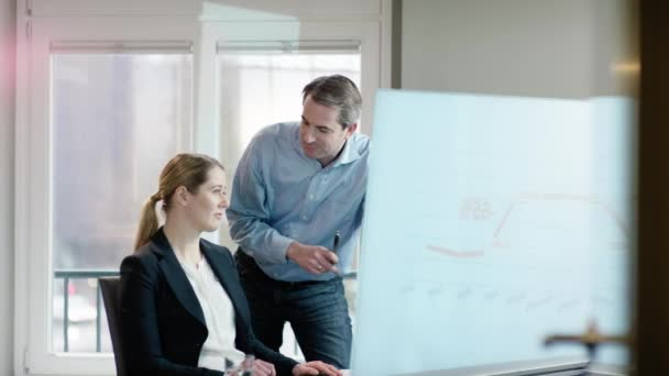 businessman discussing chart with collegue