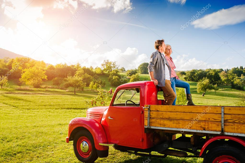 Senior couple in pickup truck
