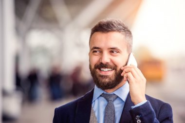 Hipster businessman making phone call