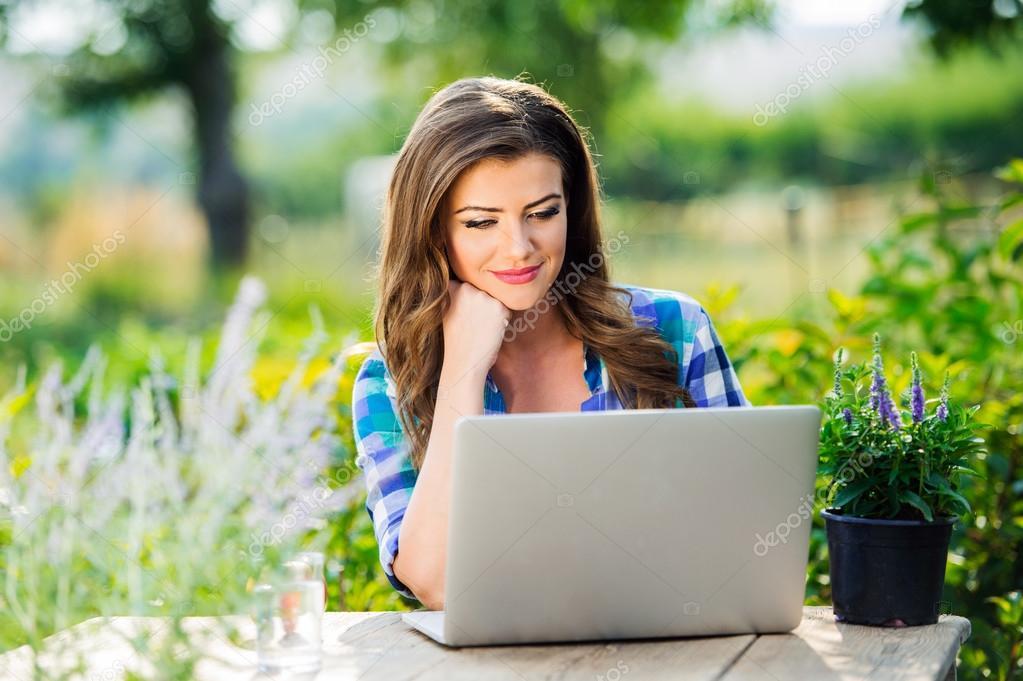 Gardener with notebook in green nature