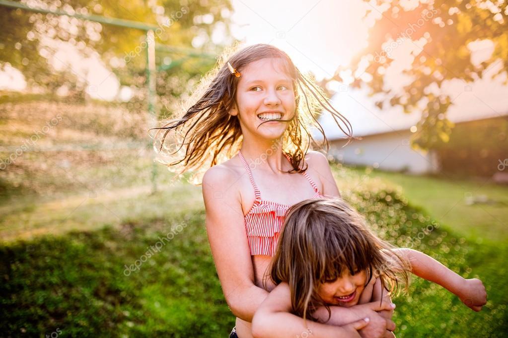 Two girls having fun in garden
