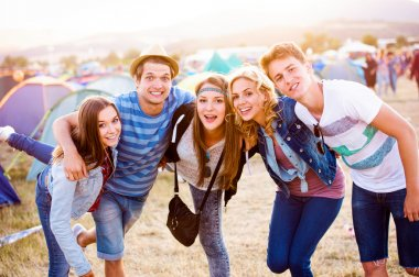 Group of teenagers at summer music festival
