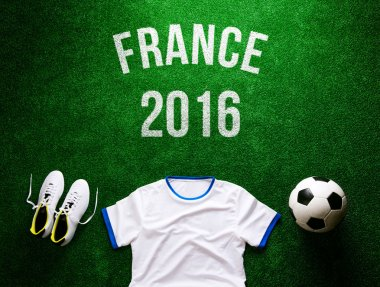 Soccer ball, boots and white t-shirt