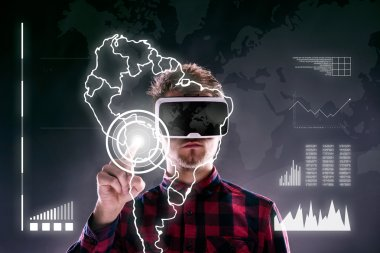 Hipster man in checked shirt wearing virtual reality goggles, reaching out. Studio shot on black background stock vector