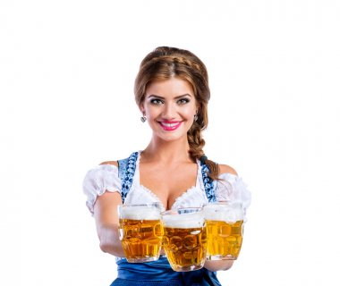 Woman in bavarian dress with beer