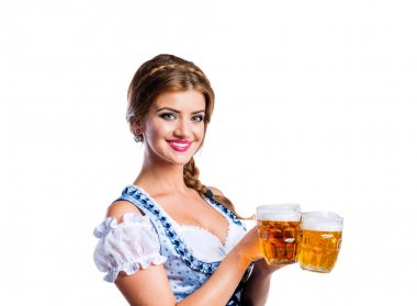 Woman in bavarian dress holding beer