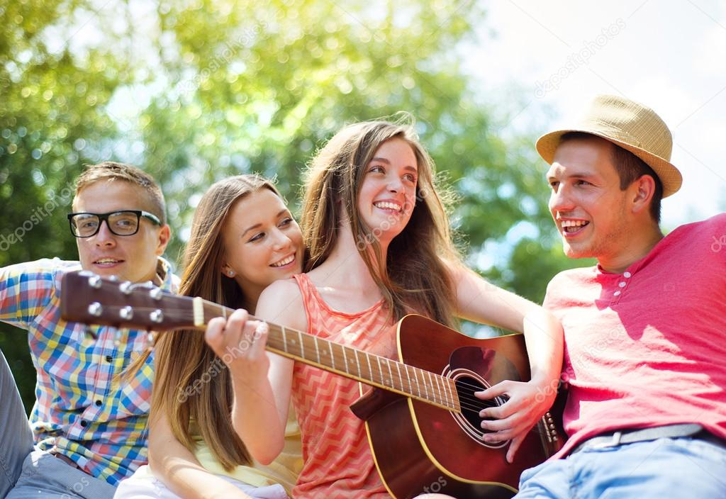 Friends with guitar having fun — Stock Photo © halfpoint ...