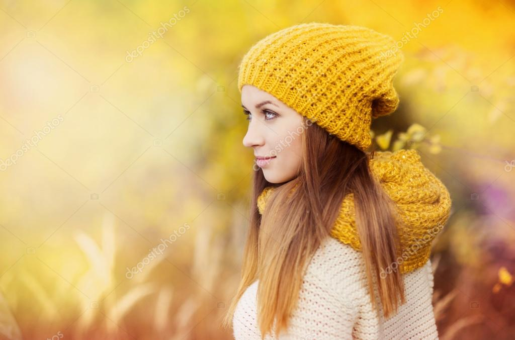 Girl with scarf and hat in autumn