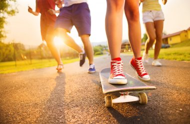 Legs of young people on skateboard