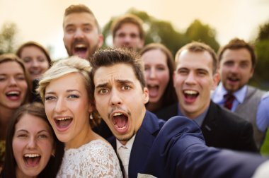 Newlyweds with their firends taking selfie
