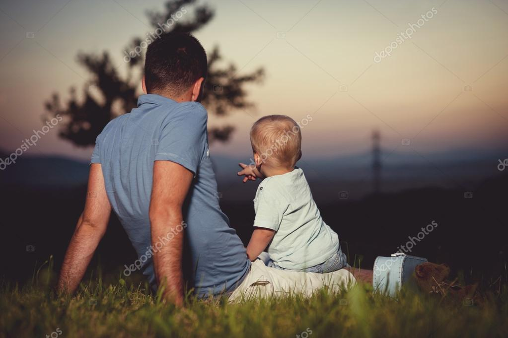 Father with son at sunset