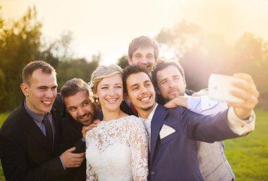 Bride, groom and his friends taking selfie