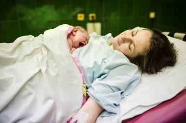 Baby girl few minutes after the birth