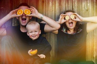 Family having fun with oranges