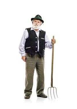 Bavarian man holding pitchfork