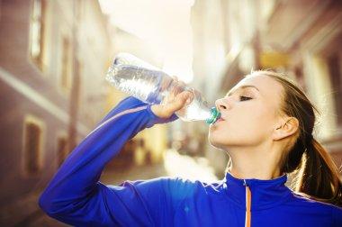 Runner drinking water during the run