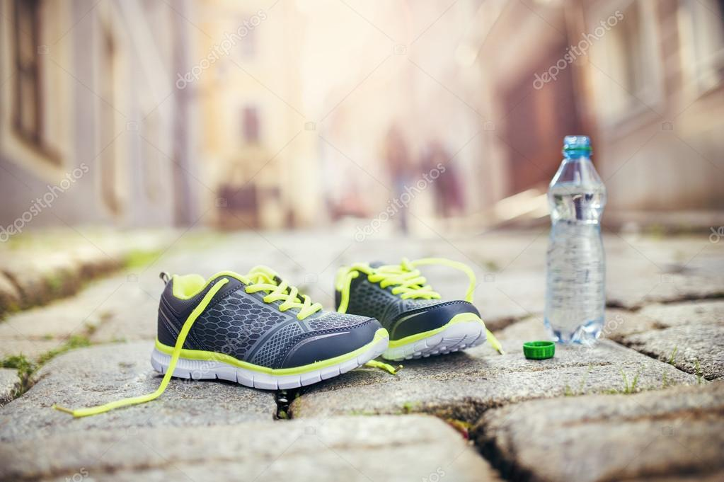 Running shoes and bottle of water