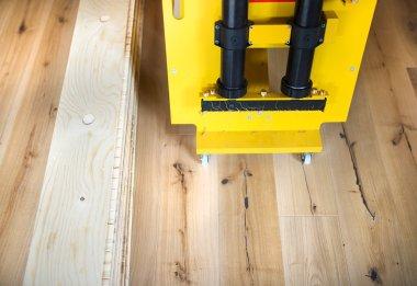 Gluing machine for gluing floor