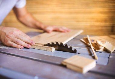 Handyman cutting plywood on circular saw