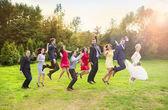 Fotografie Bridesmaids and groomsmen jumping