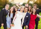Fotografie Newlywed couple having fun with bridesmaids and groomsmen