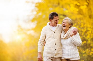Active seniors relax in nature