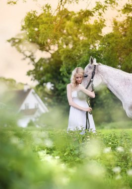 Woman walking with horse in countryside