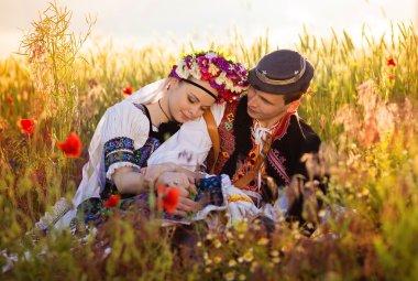 Love couple in sunset field.