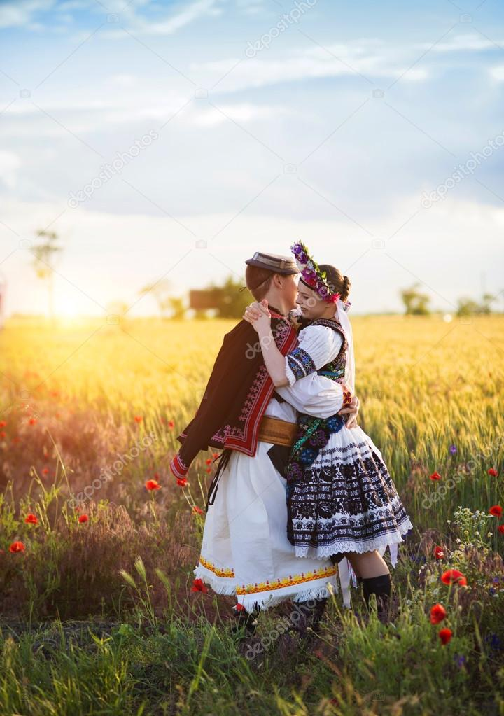 Love couple in sunset field.