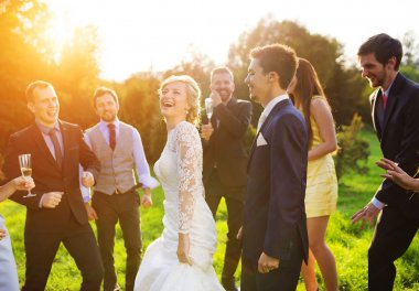 Newlywed couple dancing with bridesmaids and groomsmen
