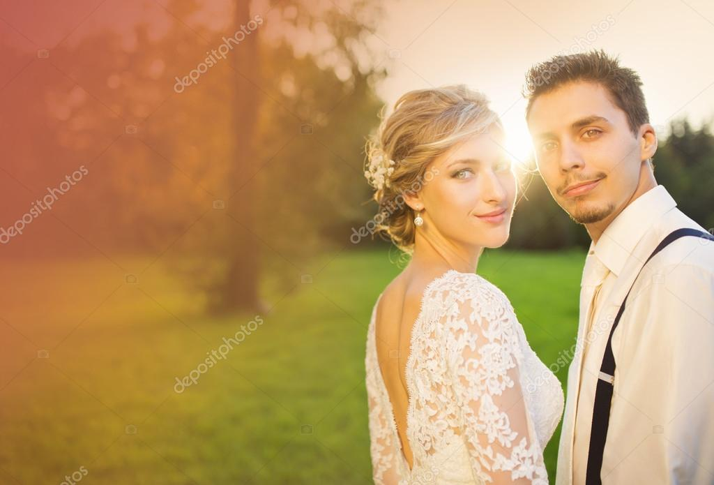 Wedding couple in summer park