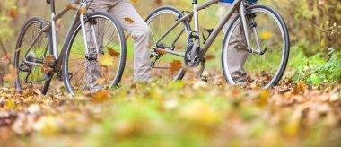 Senior couple having walk with bikes