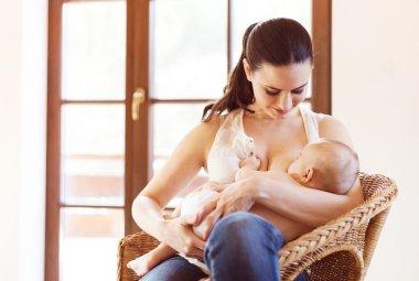 Mother breastfeeding her baby girl